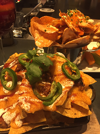 Pulled pork nachos and buffalo blue cheese chips