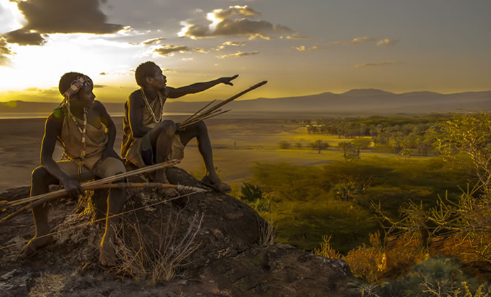 """Hadza Hunters at Sunset, Tanzania"" artwork by Carol Beckwith and Angela Fisher."