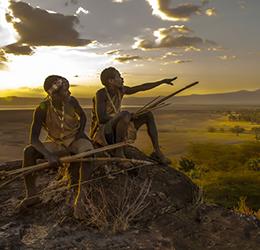 """Hadza Hunters at Sunset, Tanzania"" artwork by Carol Beckwith and Angela Fisher."