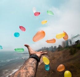 Water balloons photo by Sebastián León Prado via Unsplash