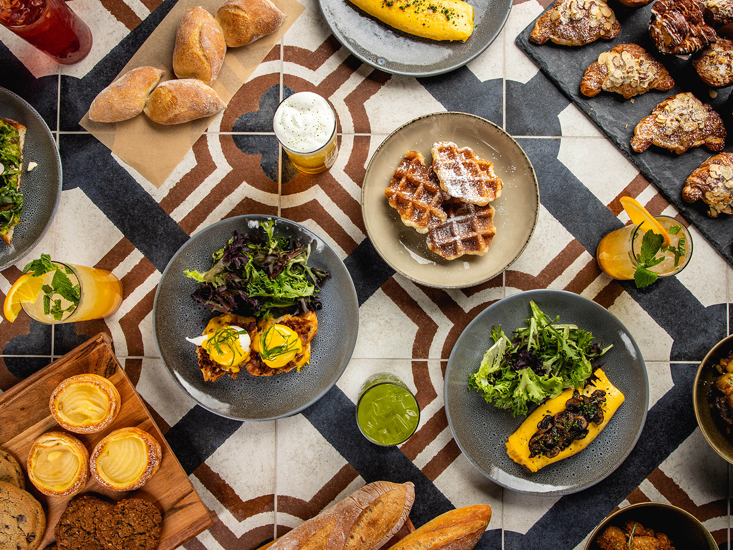Overhead food spread from Artisan by 7 Leaves Cafe and Crema Bakery photo credit Max Milla