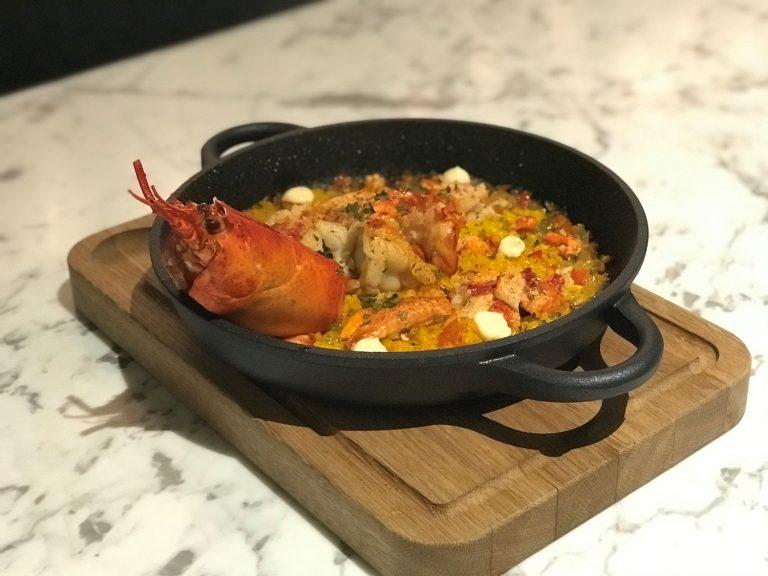 Paella De Bogavante made of Maine lobster paella sofrito photo courtesy Radisson Blu